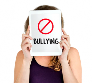 Woman holding no bullying sign